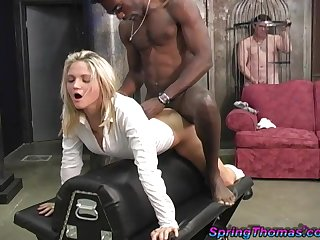 Cuckold in a cage watches Spring Thomas fucked by a black chap