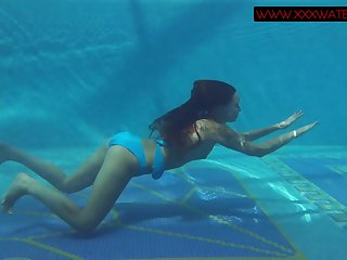 Beautiful redhead gets naked for skinny dipping fun