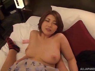 Short haired Japanese babe gives titjob and rides horseshit
