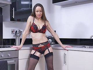 Mature brunette long haired MILF with saggy tits Josie strips