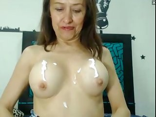 horny milf lotions her big tits and cunt on webcam