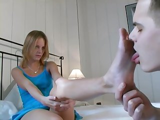 Sexy German girl makes her servant lick her fingertips and suck her toes