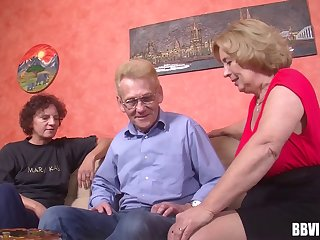 In front retirement home two grannys and a gramps strive a threesome