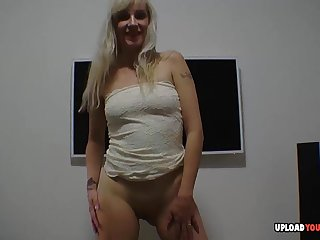Blonde babe does some dancing while piracy