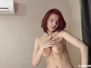 Solo redhead model Shanvia enjoys teasing with her wet off with