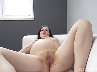 Juicy and preggie brown-haired beauty conforms a lengthy trunk